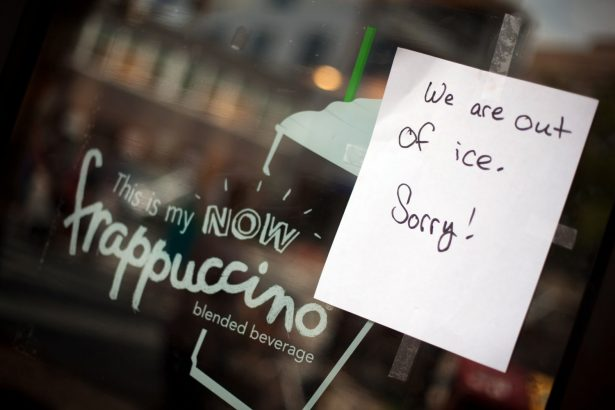 """Starbucks store sign says """"We're out of ice. Sorry!"""""""