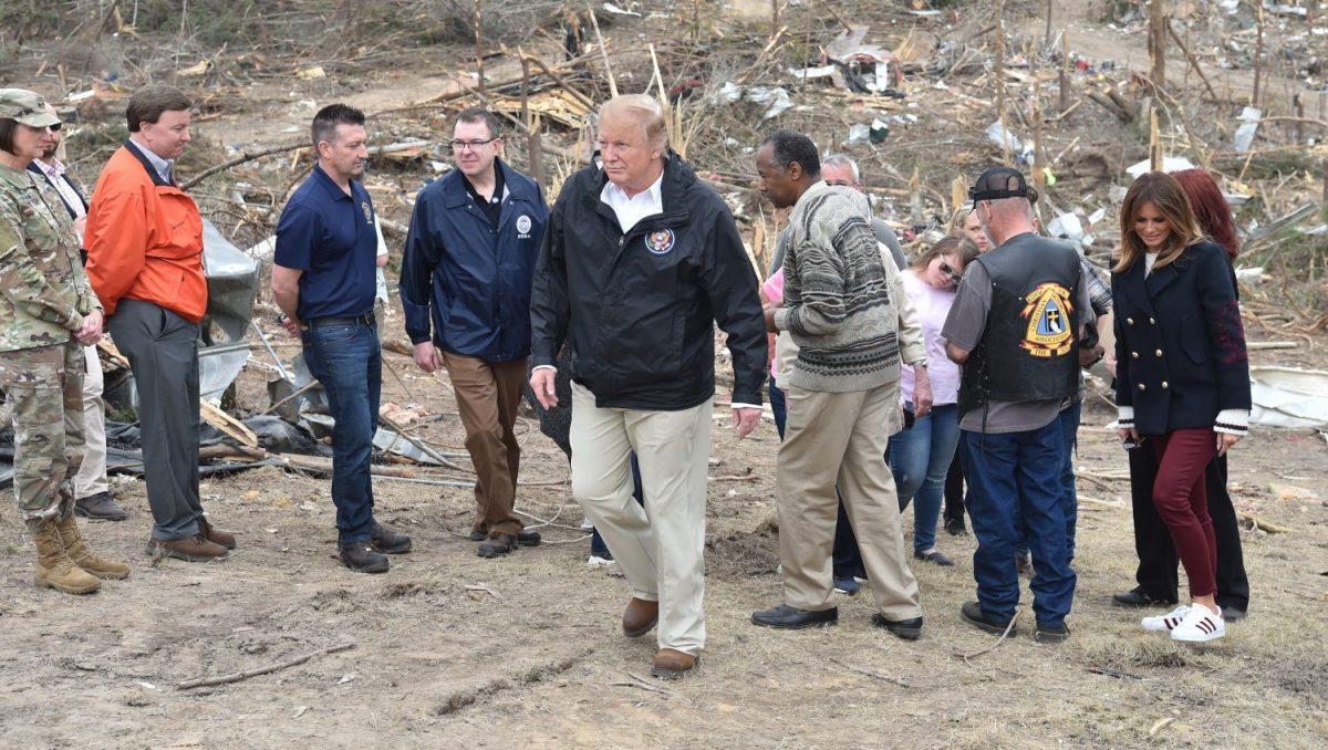 President Donald Trump tours a tornado-affected area