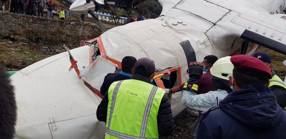 Emergency crews are seen at the site of an airplane crash in Lukla