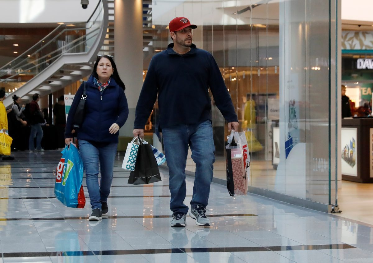 People walk with shopping bags at Roosevelt Field mall
