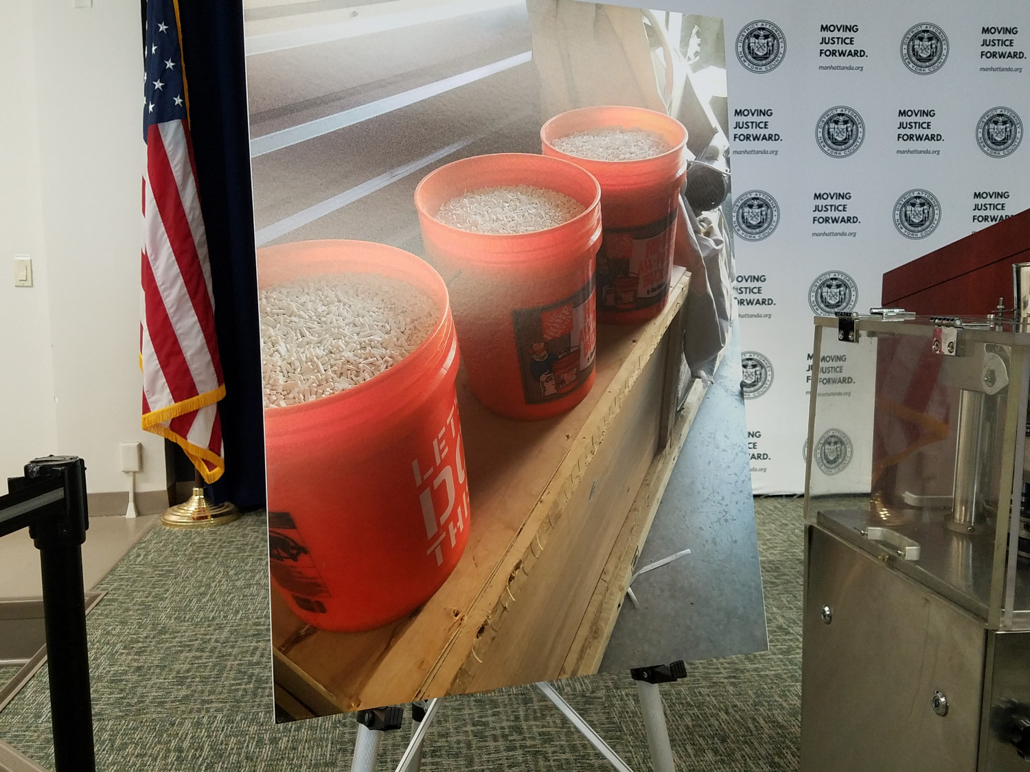 Picture of three orange buckets with pills.