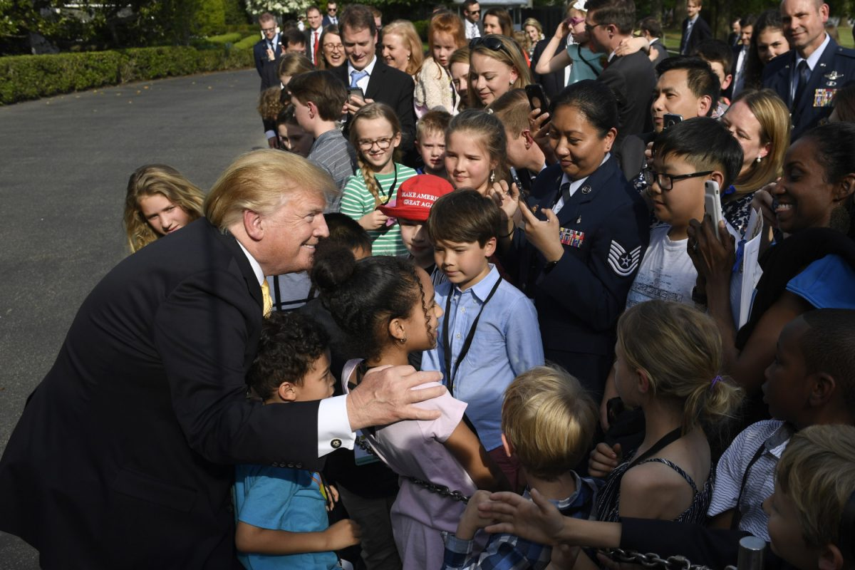 President Donald Trump greets children at White House