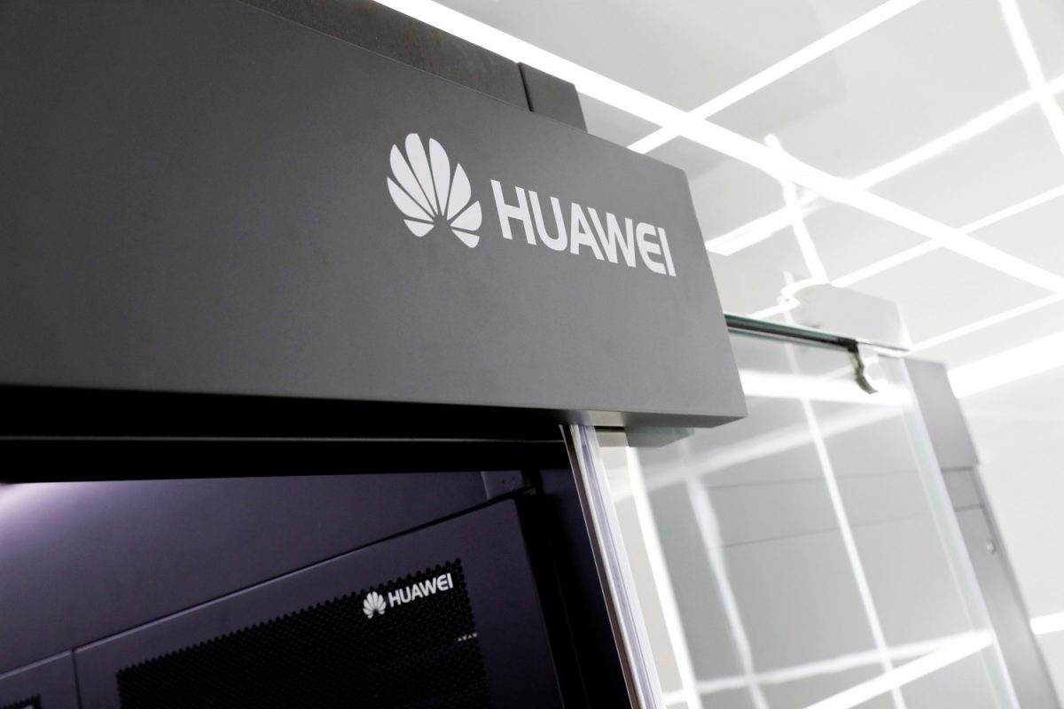 Logos of Huawei are seen on a device at its showroom in Shenzhen, Guangdong province