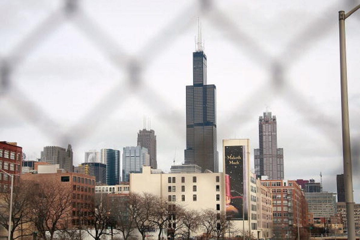 The Sears Tower rises above other buildings