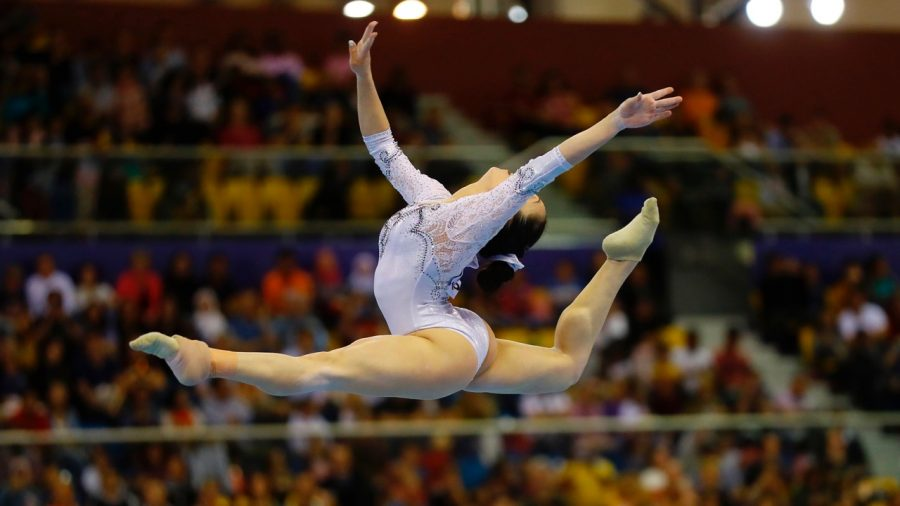 Gymnast Dislocates Knees, Snaps Ligaments During Floor Routine