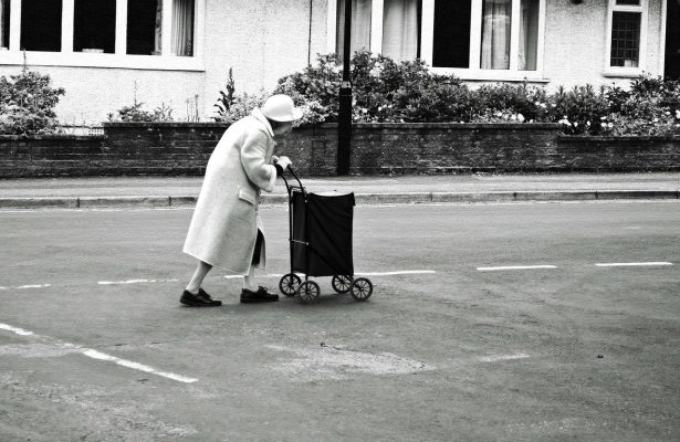 old lady pulling her cart along