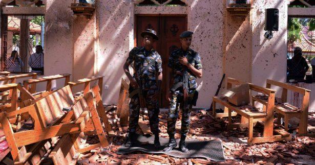 Sri Lankan military stand guard inside a church