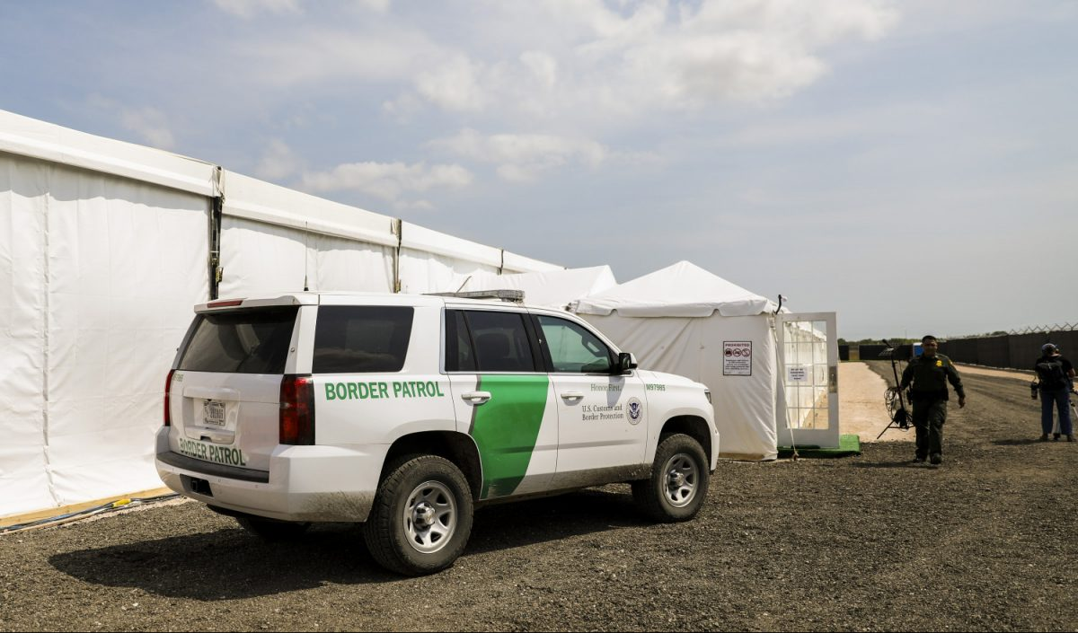 A Border Patrol truck outside tent