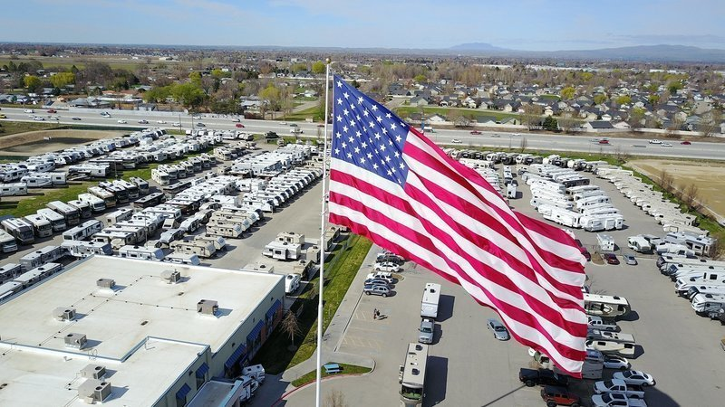 'It's not coming down': Dispute over large American flag prompts lawsuit, fines