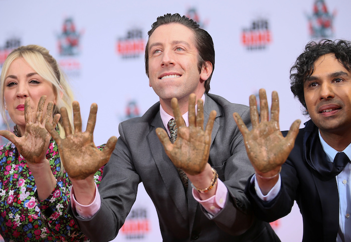 """Actors Kaley Cuoco, Simon Helberg and Kunal Nayyar participate in the cement handprints ceremony for the cast of the television comedy """"The Big Bang Theory"""" at the TCL Chinese Theatre IMAX in Hollywood, Los Angeles,"""