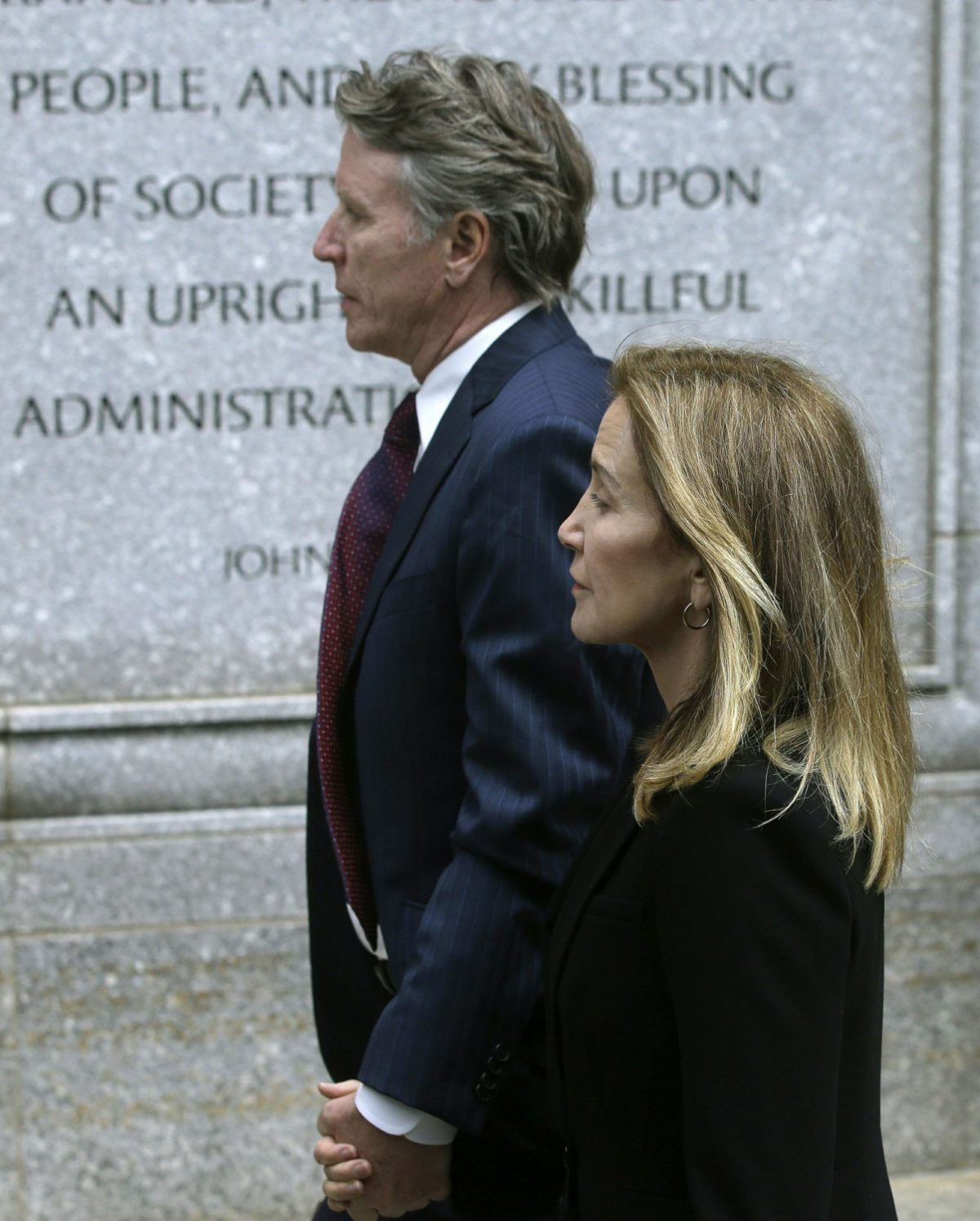 Actress Felicity Huffman arrives with her brother