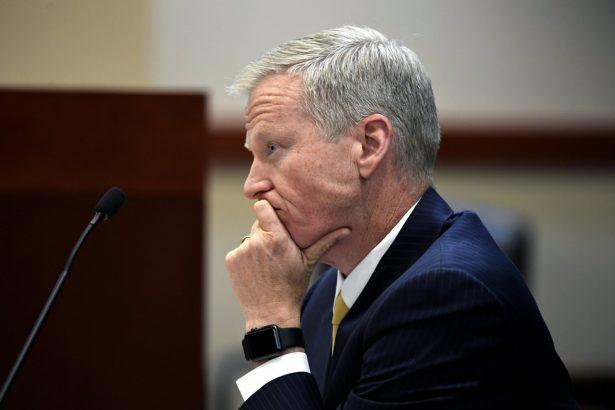 District Attorney George Brauchler listens as Devon Erickson, not pictured, appears