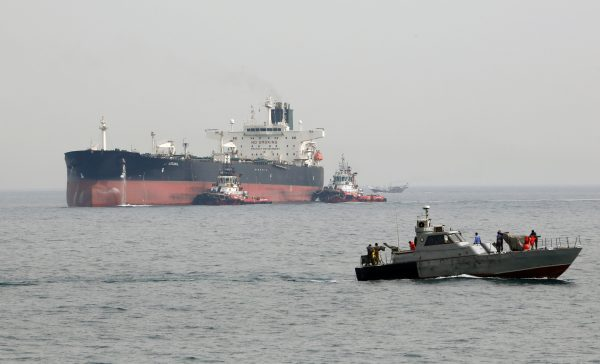 An Iranian military speedboat patrols the waters