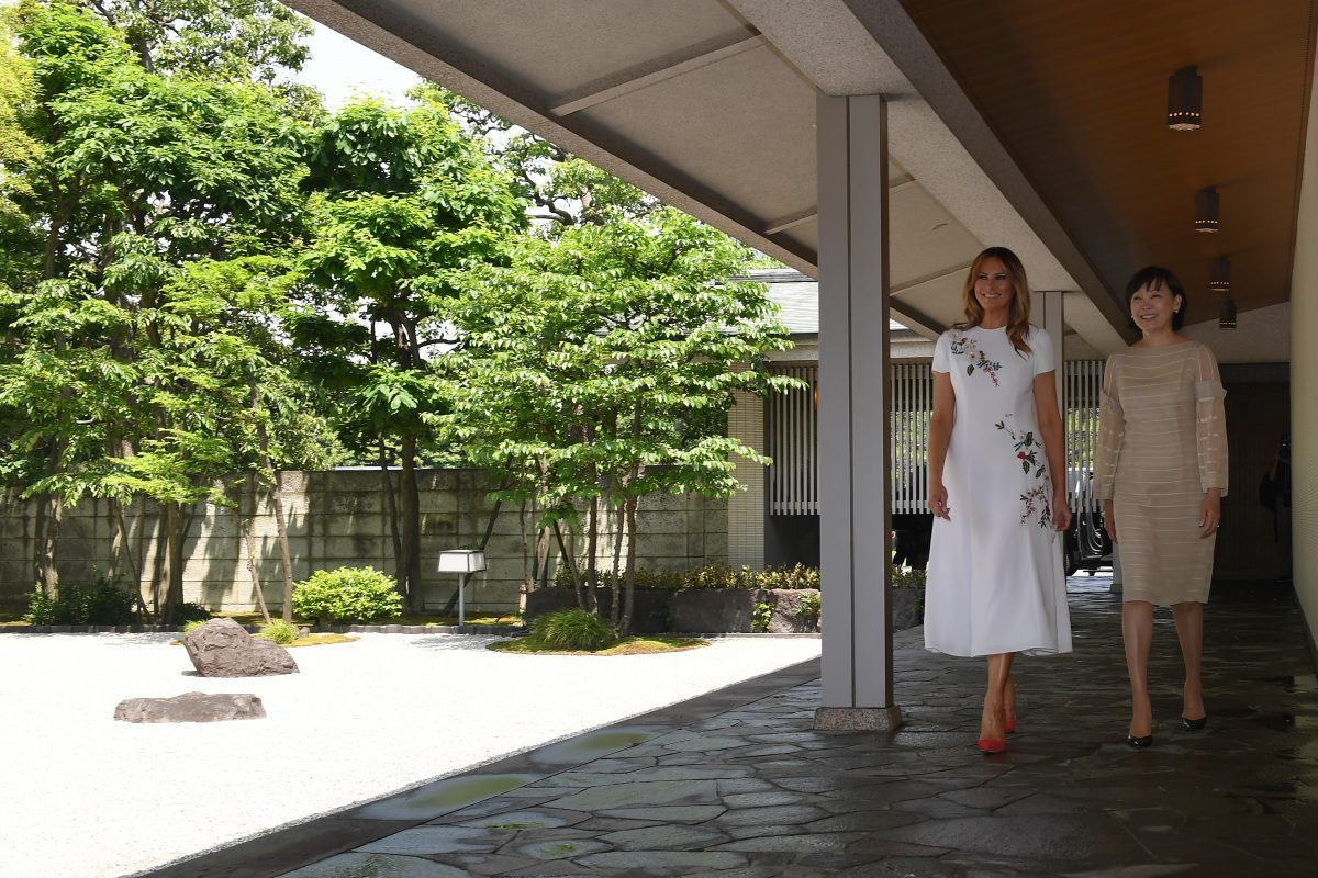 U.S. First Lady Melania Trump (L) and Japan's Premier Shinzo Abe's wife Akie enter a Japanese style annex