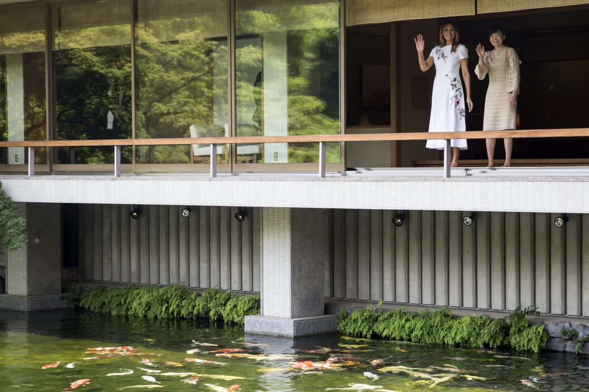 U.S. First Lady Melania Trump and Akie Abe, wife of Japanese Prime Minister Shinzo Abe wave