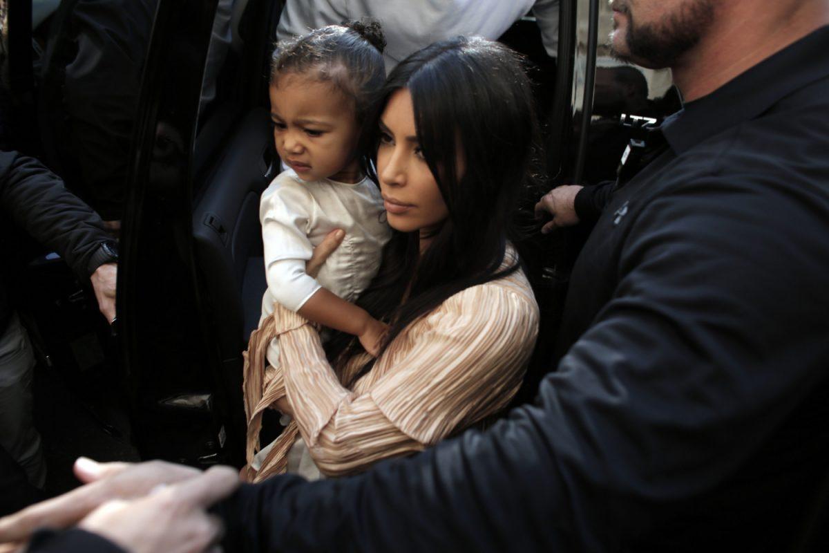 Kim Kardashian carries her daughter North West