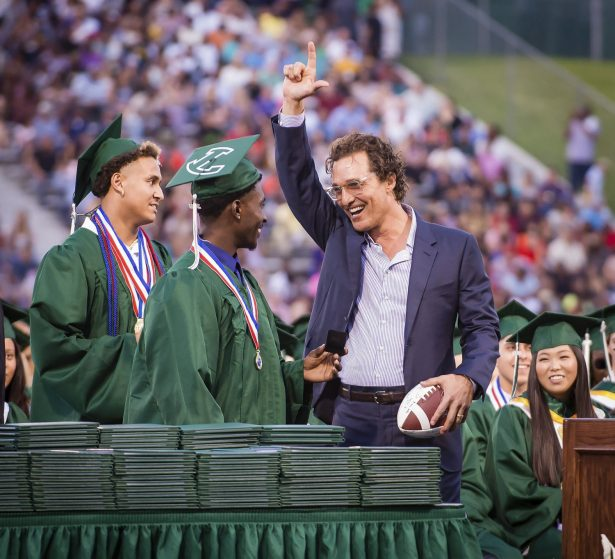 Longview Lobos Kamden Perry, left, and Jephaniah Lister present actor and 1988 Longview High School graduate Matthew McConaughey