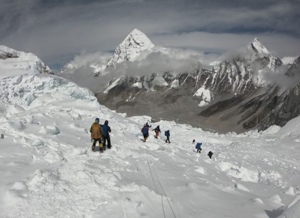 In this photo taken on April 29, 2018, mountaineers walk near camp one of Mount Everest, as they prepare to ascend on the south face from Nepal.