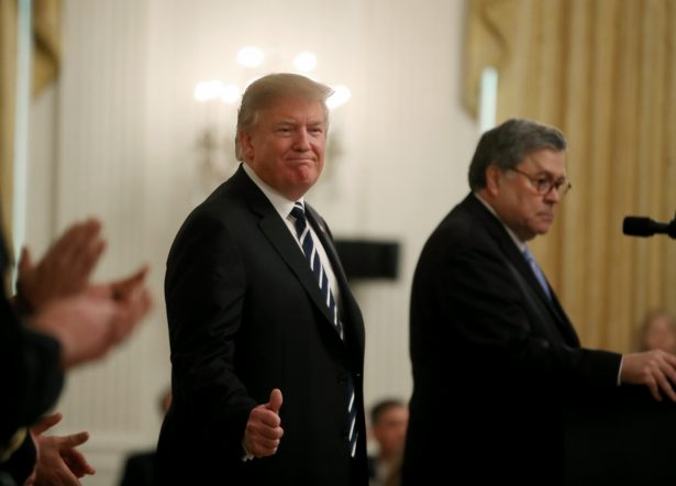 President Donald Trump (L) stands with Attorney General William Barr