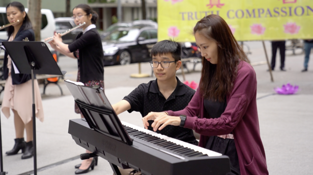16-year-old Falun Gong practitioner Aaron Wong