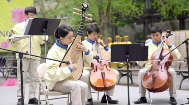 Falun Dafa Practitioners perform instruments in front the United Nations Headquarters in Manhattan on May 9, 2019