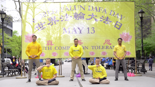 Practitioners display the exercises of Falun Dafa in front the United Nations Headquarters in Manhattan