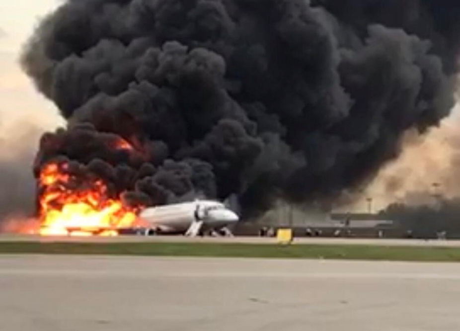 A passenger plane is seen on fire after an emergency landing at the Sheremetyevo Airport outside Moscow