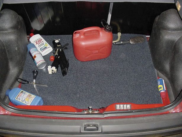 a pair scissors and a petrol container in the trunk