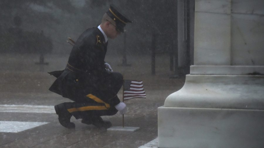 Soldier Braves Torrential Rain to Honor Fallen Comrades