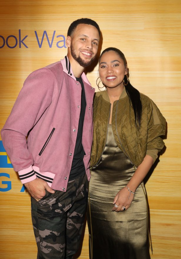 Stephen and Ayesha Curry pose for a photo on the red carpet at 16th Street Station