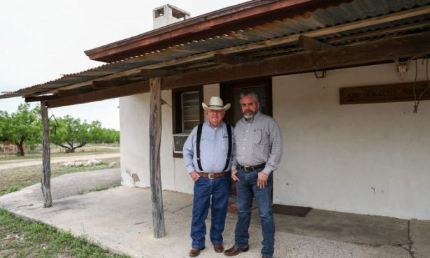 Richard Guerra (L) and his son Jody Guerra on their ranch