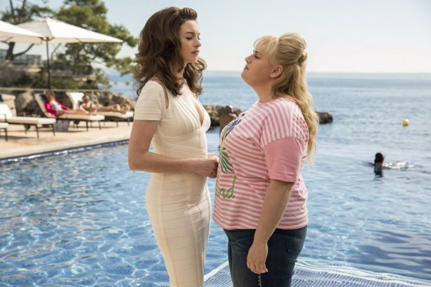 Anne Hathaway as Josephine Chesterfield, left, and Rebel Wilson as Penny Rust,
