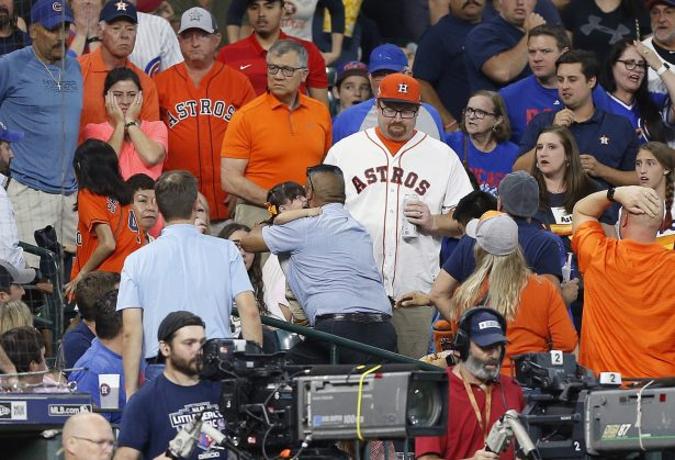A young child is rushed from the stands after being injured by a hard foul ball