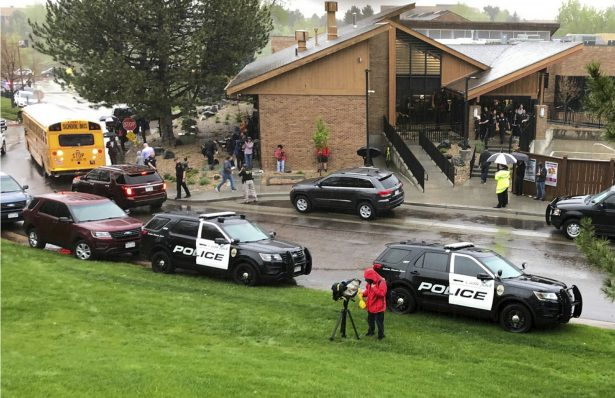 Police and others are seen outside a recreation center