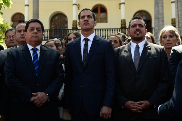 The new president of Venezuela's National Assembly Juan Guaido (C), first vice president Edgar Zambrano