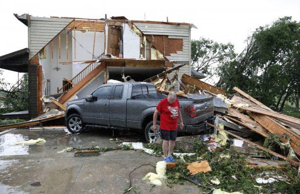 Joe Armison looks over damage to his home