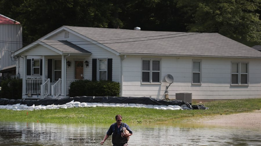 Hundreds of Roads Under Water as Historic Flooding Breaches Levees and Threatens Communities
