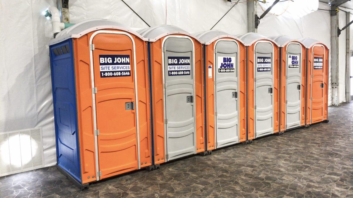 portable toilets in border tent