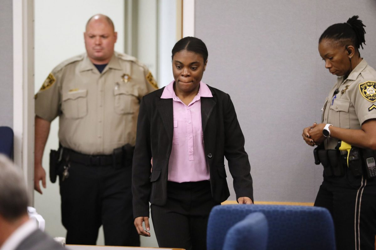 Tiffany Moss enters courtroom