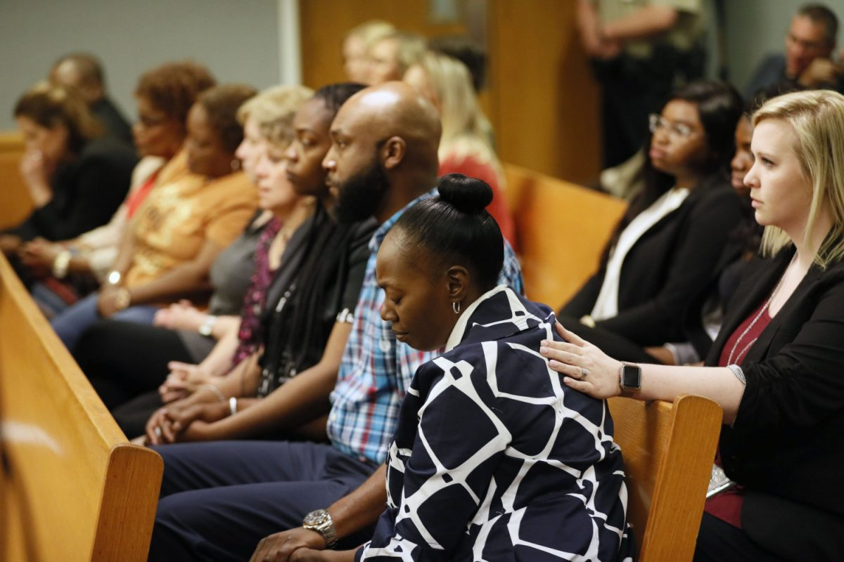 Robin Moss, front, Emani's grandmother, and others, including family members and Emani's fourth grade teacher, react as a jury sentences Tiffany Moss