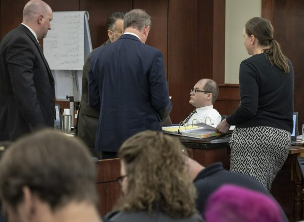 Tim Jones sits in court as his defense attorneys Rob Madsen