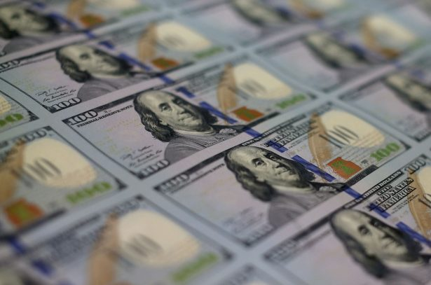 Newly redesigned $100 notes lay in stacks at the Bureau of Engraving and Printing
