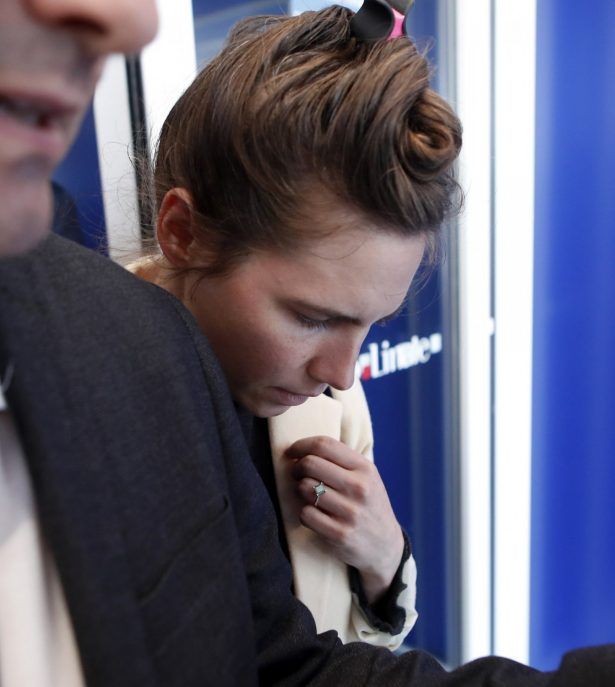 Amanda Knox is approached by a journalist upon her arrival in Linate airport,