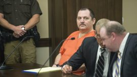 Suspect in Woman's Death Slashes Neck During Trial