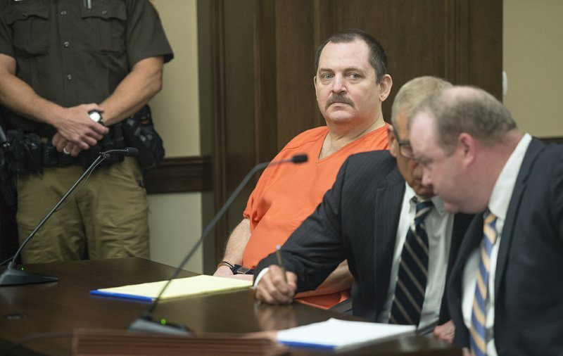 Murder suspect slashes own throat in Nebraska courtroom