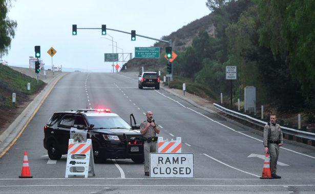 California Highway Patrol officers man a roadblock at a highway