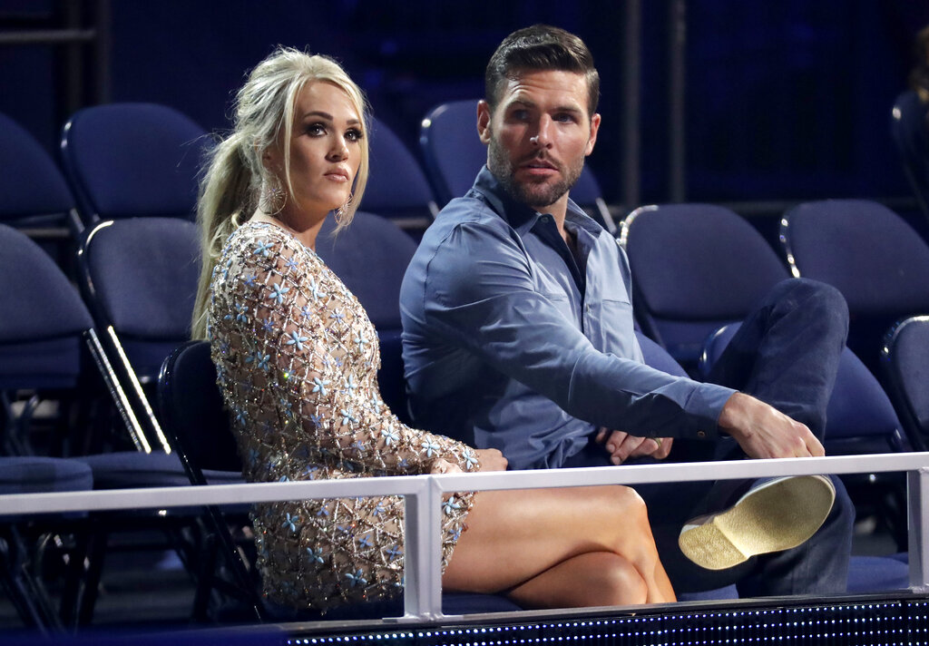 Carrie Underwood, left, and Mike Fisher appear in the audience
