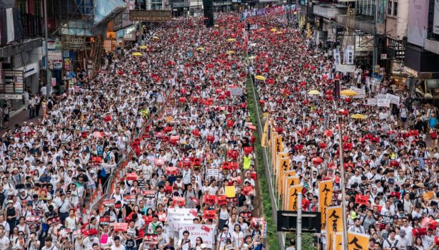 Protesters march on a street