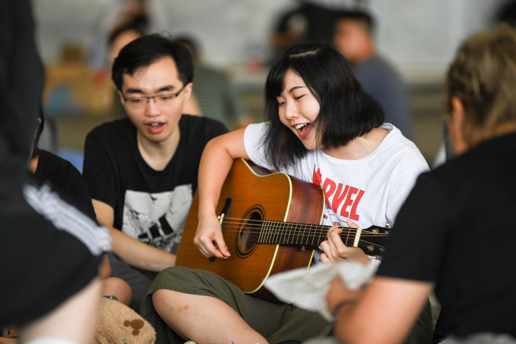 Protesters sing outside the government headquarters in Hong Kong as they continue to rally against a controversial plan to allow extraditions to mainland China on June 18, 2019. (Photo by Anthony WALLACE / AFP) (Photo credit should read ANTHONY WALLACE/AFP/Getty Images)
