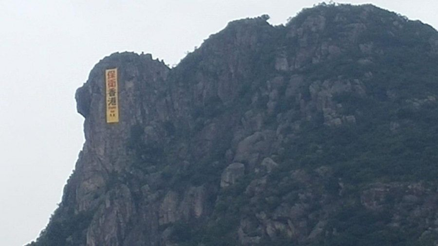 Yellow Banner Makes Brief But Striking Appearance on Hong Kong's Iconic Lion Rock
